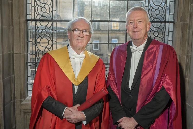 Donald MacDonald CBE and Prof Sir John Savill wearing graduation robes